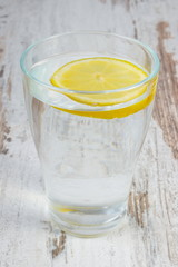Glass of clean water with slice of lemon, cold lemonade