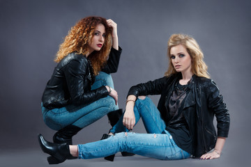 two sexy rocker girl on a dark background