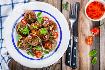 homemade meatballs with mint, green onions and chili sauce