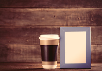cup and photo frame on the table