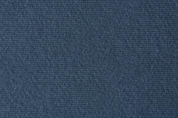 Dark blue lined paper texture background.