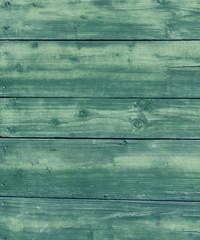 Navy blue wet wooden hangar wall.