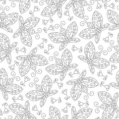 Seamless pattern with butterflies in black and white colors. Monochrome background.