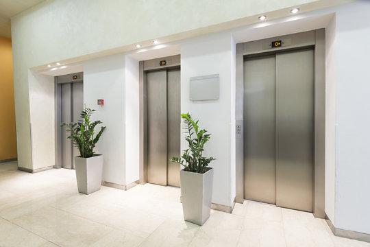 Three elevators in hotel lobby