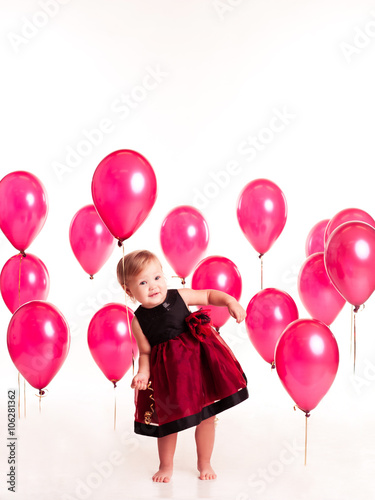 Smiling Baby Girl 1 2 Year Old Playing With Pink Balloons In Room