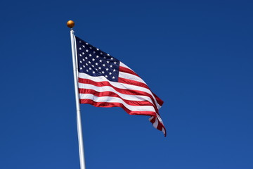American flag waving in a clear blue sky