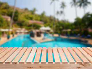 wooden bench with pool background