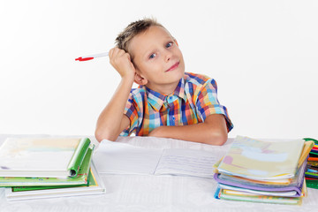 Smart school boy is thinking