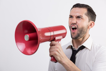 Business man holding a red loudspeaker
