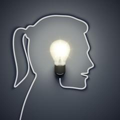 light bulb inside a female head