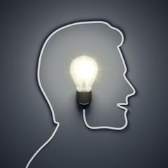 light bulb inside a male head
