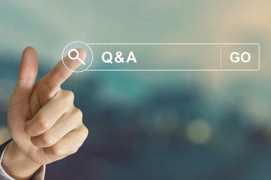 business hand clicking Q&A or Question and Answer button