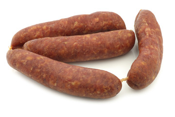 traditional Dutch smoked and dried sausages on a white background