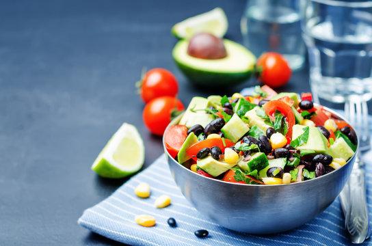 Black beans corn avocado cucumber tomato salad with lime dressin