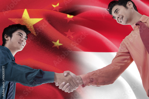 Chinese man shaking hands with indonesian person stock photo and chinese man shaking hands with indonesian person m4hsunfo