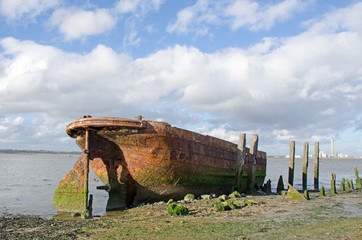 Wreck of the Tug Boat Waterloo, built in 1891 by Thomas Scott of Goole.  Tugs of this type were used to haul barges of coal on the Aire and Calder Navigation where they were known as Tom Puddings.