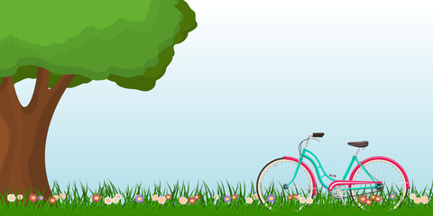 Spring landscape with a woman bike on grass and a tree