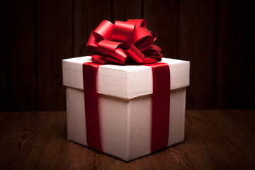 one large white gift box on a wood