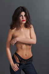 Sexy woman portrait wearing knickers and blue jeans