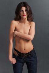 Sexy woman portrait wearing knickers and jeans
