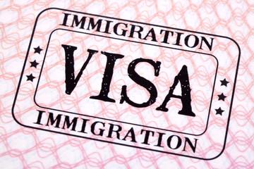 Visa document immigration stamp passport page close up