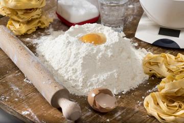 fresh homemade fettuccine on the kitchen table. Italian