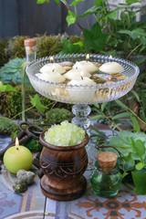 Floating candles in crystal bowl. Garden decoration.