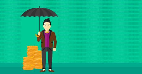 Man with umbrella protecting money.