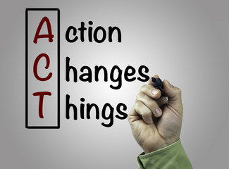 Hand with marker writing Action Changes Things (ACT), business c