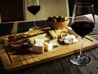 Camembert, Gouda And Brie Cheese Platter With Wine Glasses