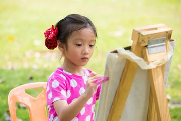 Little asian girl painitng