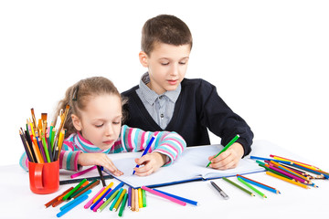 Happy funny kids draw. The boy and the girl draws pencils. Creativity concept.