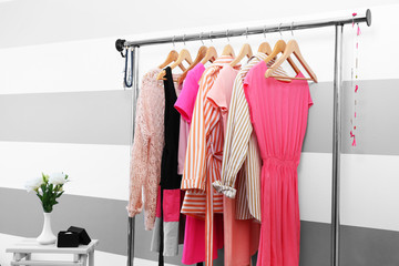 Wall Mural - Female clothes on hangers in a room