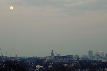 Moon and London Cityscape