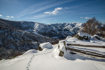 winter landscape, snow-capped mountains and fence