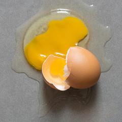 Egg drop crack splattered down on ceramic tile.