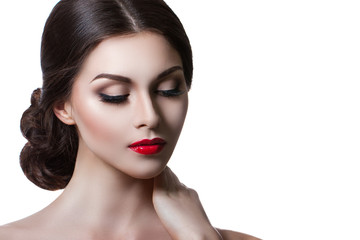 Portrait of a beautiful young woman with a professional make-up on a white background. Perfect beauty