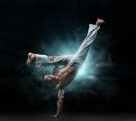 male fighter trains capoeira