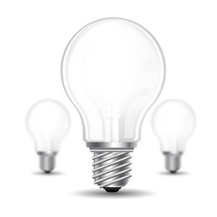 Three realistic mock up light bulb or lamp on white background. Vector illustration one bolb sharp and two bulbs depth of field