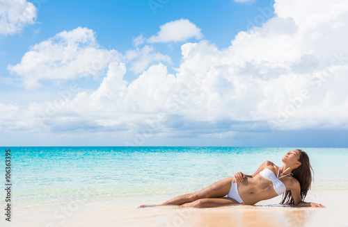 Sexy Bikini Body Woman Relaxing Sun Tanning On Beach Vacation Lying Down Sunbathing At
