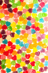 Candy and jelly colorful sweets heart-shaped background
