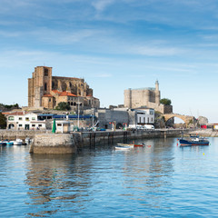Port of Castro Urdiales. In the background the church of Santa Maria de la Asuncion, the lighthouse of the Castle of Santa Ana and the medieval bridge