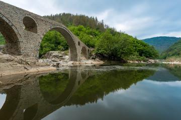 Devil's Bridge - an ancient stone bridge over the Arda River in Bulgaria, Europe