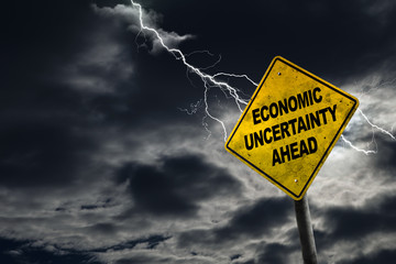 Economic Uncertainty Sign With Stormy Background and Copy Space