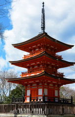 Small three story pagoda in traditional Buddhist style at Kiyomizu-dera historical site in Kyoto