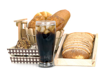 black drink (cola) and donuts and sugar over lettuce over white