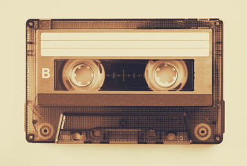 Cassette tape over solid background. vintage filtered
