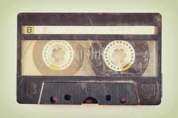 Cassette tape over solid background. vintage filtered