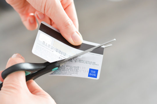 Cutting a credit card suggesting bankruptcy problems