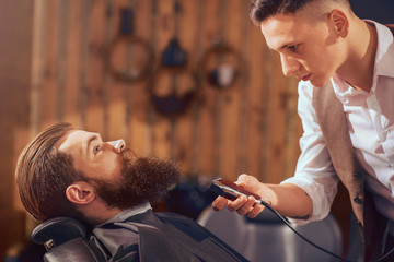Nice man sitting in the barbershop